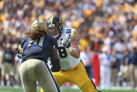 Iowa offensive lineman Brandon Scherff blocks Pitt defensive lineman Darryl Render during the game at Heinz Field in Pittsburgh, Pennsylvania on Saturday, Sept. 20, 2014. Iowa defeated Pitt, 24-20. (The Daily Iowan/Tessa Hursh)