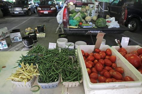 Fresh produce sits out at the Farmer's Market on Wednesday, Sept. 9, 2015. A new study from the UI shows that the number of farmer's markets has gone up and more people are buying their food locally.