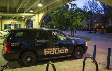 Iowa City police officers respond to reported gunshots Friday night