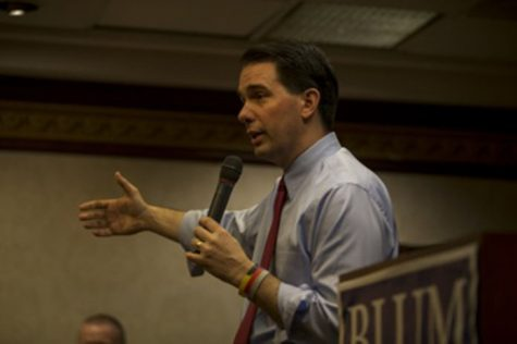 Wisconsin Gov. Scott Walker gives a speech during a fundraiser for Rep. Rod Blum at the Cedar Rapids Marriott on Friday, April 24, 2015. Walker, a rising conservative leader, said he will make a decision on a 2016 presidential campaign in June. (The Daily Iowan/Peter Kim)