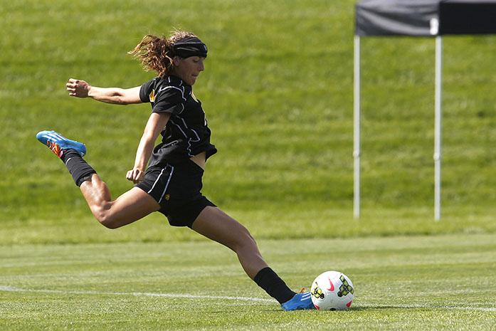 Iowa defender Melanie Pickert takes a penalty kick during the game at the Iowa Soccer Complex on Sunday, Sept. 14, 2014. Iowa defeated Northwestern, 1-0. (The Daily Iowan/John Theulen)