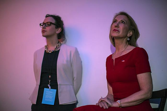 Former Hewlett Packard CEO Carly Fiorina watches a speech being given on a screen during the Lincoln Dinner in Des Moines on Saturday, May 16, 2015. Fiorina was cut off during her speech as she ran over her time allotted to the dismay of most in attendance who voiced their displeasure in her abrupt and forced conclusion. (The Daily Iowan/Sergio Flores)