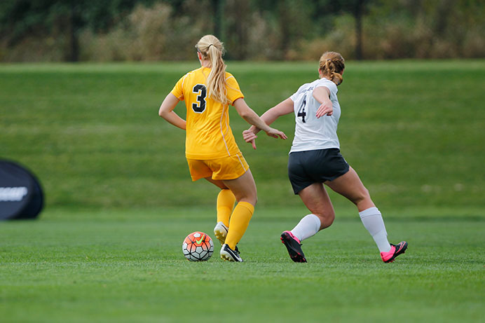 Iowa defender Morgan Kemerling kicks the ball against Penn State forward Megan Schafer at the Iowa Soccer Complex on Sunday, Sept. 27, 2015. Iowa lost to Penn State, 5-1. (The Daily Iowan/Courtney Hawkins)
