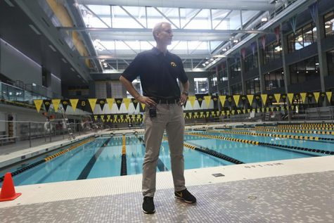 Iowa head coach Marc Long talks to the reporters during media day at the CRWC on Wednesday, Oct. 1, 2014. The swimming team opens there season at home this Friday hosting Michigan and Nebraska.