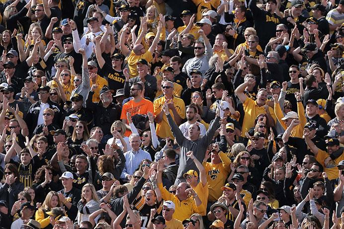 Iowa fans cheer during the Homecoming game against Illinois in Kinnick Stadium on Saturday, Oct. 10, 2015. The Hawkeyes defeated the Illini, 29-20. (The Daily Iowan/Valerie Burke)