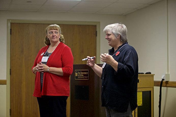 """Laurie Haag and Linda Stewart Kroon from the Women's Resource and Action Center discuss the importance of active listening to participants of a workshop at the IMU on Thursday, Oct. 15, 2015. The GWSS department held a symposium called """"Social Justice After Ferguson."""" The symposium included workshops for faculty and students, lectures, and a panel discussion. (The Daily Iowan/Mikaela Parrick)"""