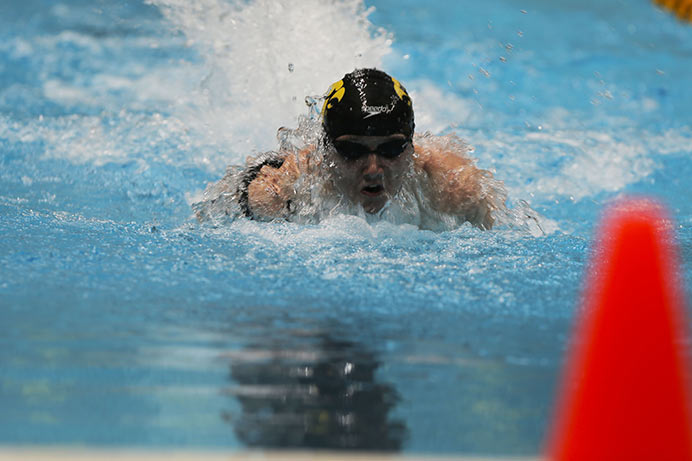 RJ Hemmingsen comes up for a breath against Michigan State Thursday night October 15th, 2015 in Iowa City. Hemmingsen was competing in the 100 yard IM. (The Daily Iowan/Kyle Close)