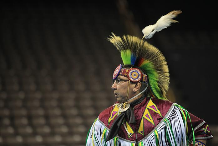 A+performer+dances+at+Powwow+in+Carver-Hawkeye+Arena+on+Saturday%2C+April+11%2C+2015.+Powwow+celebrates+American+Indian+song+and+dance%2C+and+is+put+on+by+the+Native+American+Student+Association.+%28The+Daily+Iowan%2F+Rachael+Westergard%29