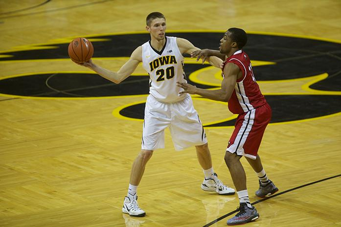 Iowa forward Jarrod Uthoff looks for an open player during the Iowa-Northern Illinois game in Carver-Hawkeye Arena on Wednesday, Nov. 26, 2014. The Hawkeyes defeated the Huskies, 70-49. (The Daily Iowan/Margaret Kispert)