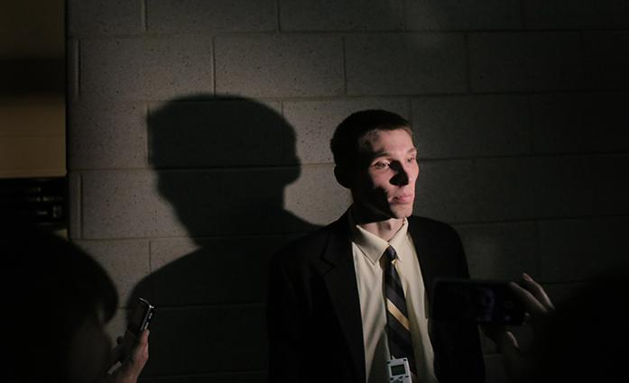Iowa forward Jarrod Uthoff talks to reporters outside the locker room after the Iowa-Northwestern game in Welsh-Ryan Arena on Sunday, Feb. 15, 2015. The Hawkeyes lost in overtime to the Wildcats, 66-61. (The Daily Iowan/Margaret Kispert)