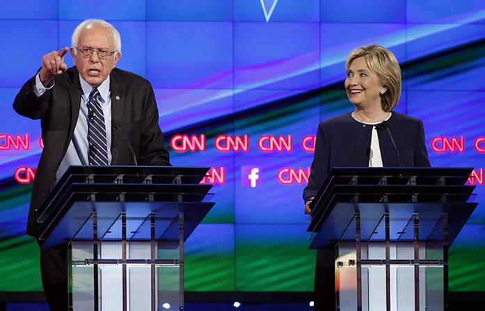 Sen.+Bernie+Sanders%2C+of+Vermont%2C+left%2C+speaks+as+Hillary+Rodham+Clinton+looks+on+during+the+CNN+Democratic+presidential+debate+Tuesday%2C+Oct.+13%2C+2015%2C+in+Las+Vegas.+%28AP+Photo%2FJohn+Locher%29