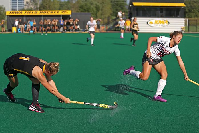 Iowa midfielder Chandler Ackers hits the ball past Stanford Clemence Couteau during the Iowa-Stanford game at Grant Field on Thursday, Sept. 10, 2015. The Hawkeyes were defeated Cardinals, 3-2 after getting a side goal with zero seconds left. (The Daily Iowan/Margaret Kispert)
