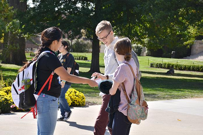Students from the Native American Student Association hand out fliers for Indigenous Peoples Day on the Pentacrest at the University of Iowa on Otcober 12, 2015. (The Daily Iowan/Karley Finkel)