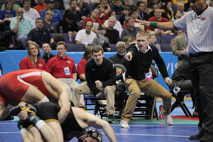 Iowa head coach Tom Brands and assistant coach Ryan Morningstar react during the 174 pound bout of Session V of the 2015 Division 1 Wrestling Championships at the Scottrade Center on Saturday, March 21, 2015 in St. Louis, Missouri. Kokesh defeated Evans 6-4 in overtime. (The Daily Iowan/Rachael Westergard)