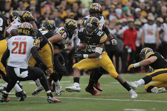 Iowa running back Akrum Wadley runs with the ball during the Iowa-Maryland game at Kinnick Stadium on Saturday, Oct. 31, 2015. The Hawkeyes defeated the Terrapins to stay undefeated, 31-15. (The Daily Iowan/Margaret Kispert)