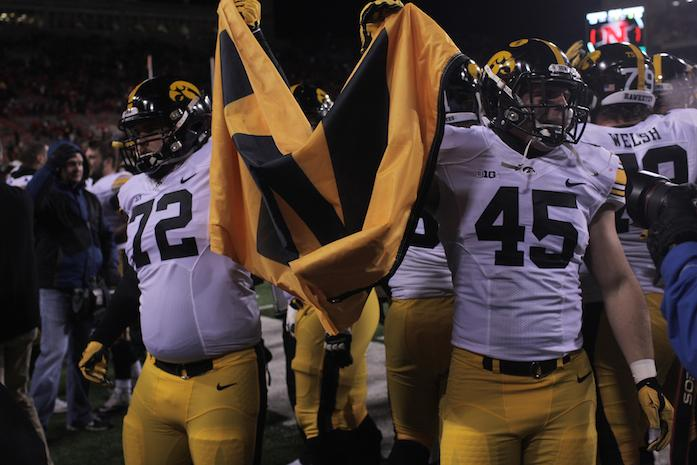 Iowa+lineman+Brant+Gressel+and+fullback+Drake+Kulick+hold+up+a+W+flag+after+the+Iowa-Nebraska+game+at+Memorial+Stadium+on+Friday%2C+Nov.+27%2C+2015.+The+Hawkeyes+defeated+the+Cornhuskers%2C+28-20%2C+to+finish+off+a+perfect+regular+season.+%28The+Daily+Iowan%2F+John+Theulen%29