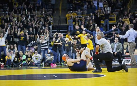 Illinois 174-pounder Zac Bruson and Iowa's Alex Meyer react to the last second pin during the Iowa-Illinois duel in Carver-Hawkeye Arena on Friday, Jan. 16, 2015. Meyer pinned Brunson in 6:59. The Hawkeyes defeated the Fighting Illini, 25-12. (The Daily Iowan/Margaret Kispert)