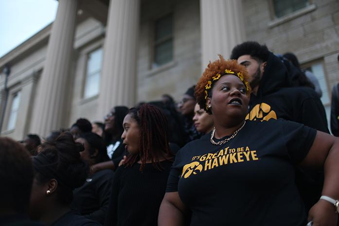 Iowa+senior+Mariah+Dawson+stands+in+a+group+for+a+photo+on+the+steps+of+the+Old+Capitol+building+during+a+demonstration+of+solidarity+in+Iowa+City+on+Wednesday.+Students+gathered+in+reaction+to+alleged+racially+driven+incidents+on+the+University+of+Mizzous+campus.+%28The+Daily+Iowan%2FBrooklynn+Kascel%29