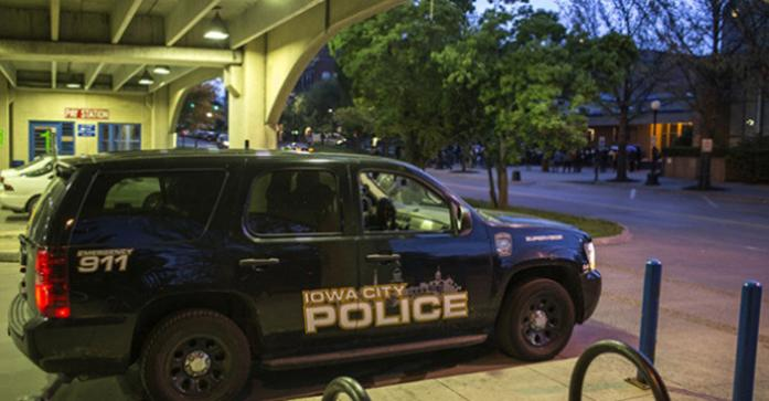 A police car sits inside the a parking garage on May 4, 2015.  (The Daily Iowan/Sergio Flores)