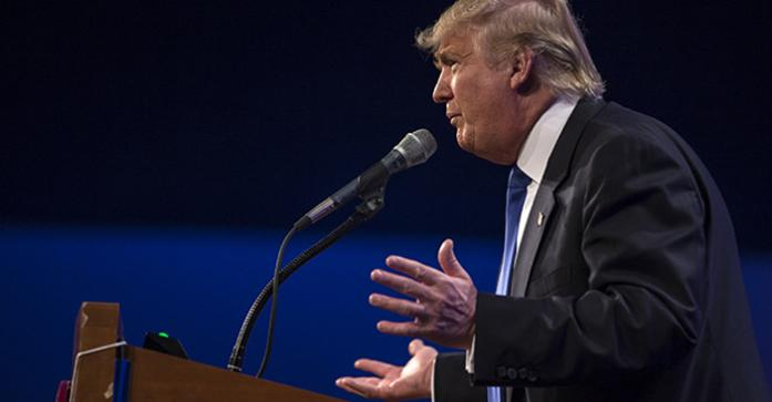 FILE - In this file photo then-Republican Candidate Donald Trump delivers a speech at the Lincoln Dinner in Des Moines on Saturday, May 16, 2015.