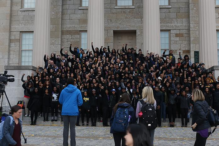 Demonstrators gather on the westside steps of the Old Capital Museum for a photo on Wednesday, Nov. 11, 2015. Demonstrators gathered in an effort to show support and solidarity for students of color at the University of Missouri. Timothy M. Wolfe recently resigned as the President of Mizzou amid criticism and protests over the administrations handling of what were viewed as discriminatory incidents. (The Daily Iowan/Joshua Housing)