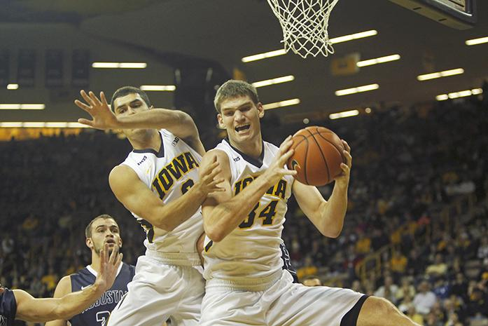 Iowa center Adam Woodbury grabs a rebound against Augustana in Carver-Hawkeye Arena on Friday, Nov. 6, 2015. The Vikings defeated the Hawkeyes, 76-74. (The Daily Iowan/Joshua Housing)