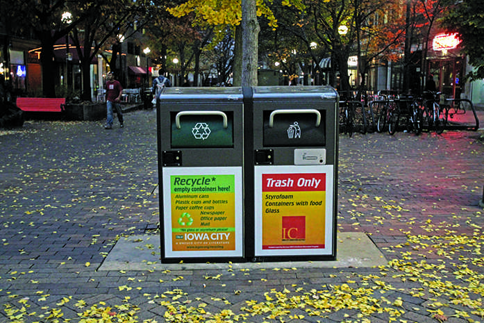 Two new solar powered trash and recycling cans sit in the ped mall on Wednesday, Nov 4, 2015. There are currently four downtown, and if proven successful the city will put in more. (The Daily Iowan/Lexi Brunk)