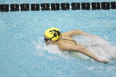 Izzie Bindseil competes in the  Womens 100 yard Butterfly in the 2014 Black and Gold Intrasquad meet on Saturday, Oct. 2014 at the CRWC. The Black squad defeated the Gold squad, 86.5 - 85.5. (The Daily Iowan/Joshua Housing)