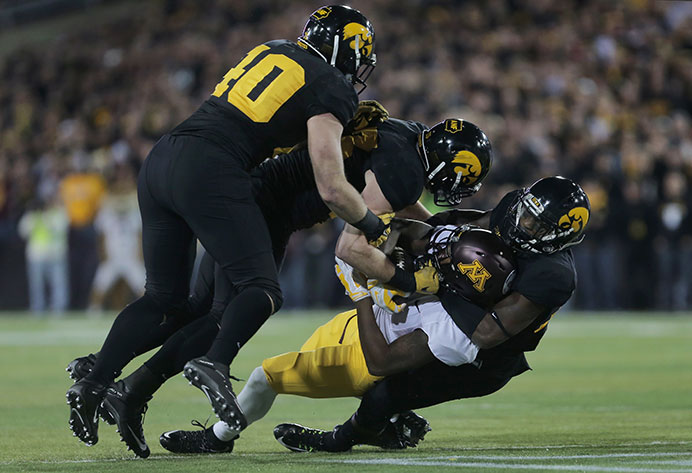 Minnesota wide receiver KJ Maye is brought down by Iowa defensive back Desmond King during the Iowa-Minnesota game at Kinnick Stadium on Saturday, Nov. 14, 2015. The Hawkeyes defeated the Golden Gophers, 40-35. (The Daily Iowan/Margaret Kispert)