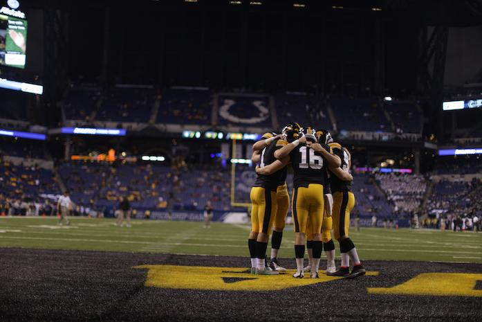 The Iowa kicking team huddles before the Big Ten Championship Game against Michigan State in Lucas Oil Stadium in Indianapolis, Indiana on Saturday, Dec. 5, 2015. (The Daily Iowan/Alyssa Hitchcock)