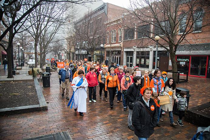 Over a 100 individuals from the community gathered downtown for the march, Moms Demand Action for Gun Sense in America marched to bring awareness to gun violence and the need for strict gun laws throughout the country in downtown Iowa City, Iowa on Sunday. (The Daily Iowan/Anthony Vazquez)