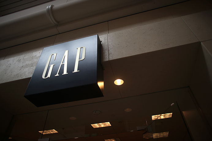 The Gap holds a 40% off sale in Coral Ridge Mall on Monday, Dec. 14, 2015 in preparation for its closing. In order to make improvements to the company, 175 different store locations will be closing their doors over the next few years. This location will be officially closed by Jan. 26, 2016  (The Daily Iowan/Brooklynn Kascel)