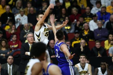 Iowa's Nicholas Baer shoots over a Drake player. The Hawkeyes beat the Bulldogs 70-64 in the Big Four Classic (Joshua Housing/The Daily Iowan)