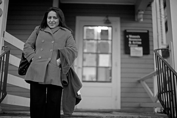 Gabriela Rivera leaves the goodbye party for the WRACs blue house on, Thursday Dec 3, 2015. The Blue House that has been the centers headquarters since its beginning will be demolished come January. (The Daily Iowan/Jordan Gale)