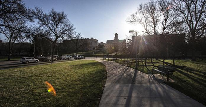 The sun rises behind the Old Capitol in Iowa City on Friday, April 10, 2015. Rand Paul was in town to drum up support after announcing his intention to run for president earlier this week.. (The Daily Iowan/Sergio Flores)