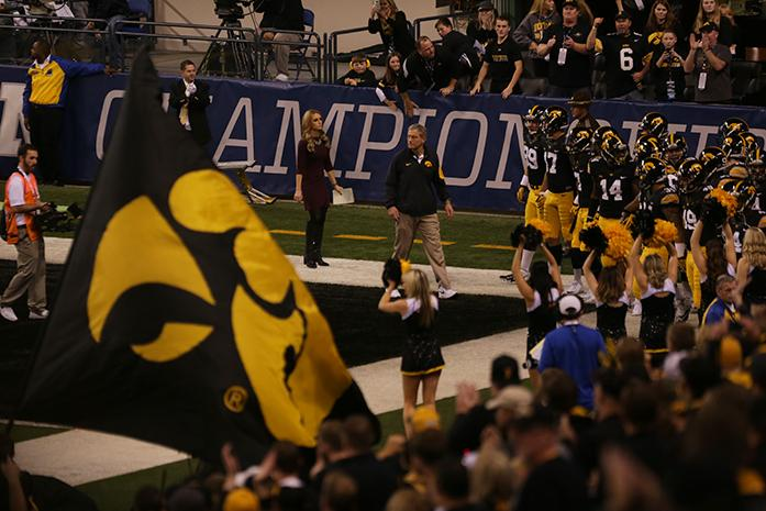 Iowa runs out for the second half of the Big Ten Championship against Michigan State in Lucas Oil Stadium in Indianapolis, Indiana on Saturday, Dec. 5, 2015. The Spartans defeated the Hawkeyes, 16-13. (The Daily Iowan/Alyssa Hitchcock)
