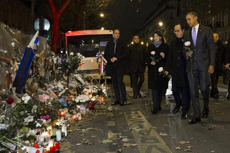 President Barack Obama, right, French President Francois Hollande, second from right, and Paris Mayor Anne Hidalgo arrive at the Bataclan, site of one of the Paris terrorists attacks, to pay their respects to the victims, after Obama arrived in town for the COP21 climate change conference, on Monday, Nov. 30, 2015, in Paris. (AP Photo/Evan Vucci)