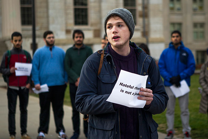 UI senior Carter Yerkes gives a speech at the east side of the Pentacrest on Dec 11. The rally promoted an anti-hateful message and love. (The Daily Iowan/Peter Kim)