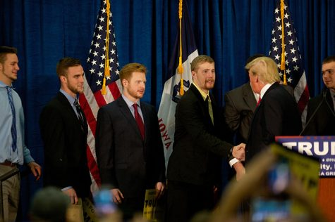 Members of the University of Iowa Wrestling Team meet Donald Trump at a political rally in the Field House on Tuesday, Jan. 26. Trump visited Iowa City to try and persuade voters to caucus for him next week. (The Daily Iowan/Brooklynn Kascel)