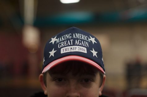 A Donald Trump supporter wears a Trump 2016 hat at the Field House on Tuesday. Trump is in a close race in Iowa with Sen. Ted Cruz. (The Daily Iowan/Brooklynn Kascel)