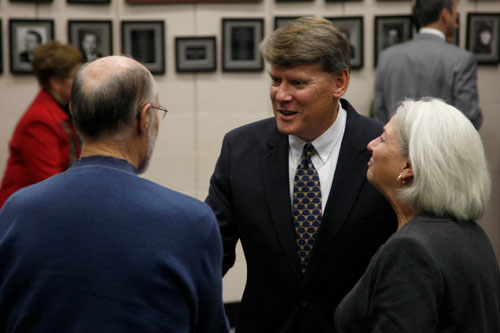 New City Manager Tom Markus shakes hands with people at a reception in his honor on Thursday in City Hall. The line of eager attendees stretched out the door, with people wearing anything from suits to sweatshirts and plenty of men in uniform, all waiting for a handshake and a little face time with the new city manager.