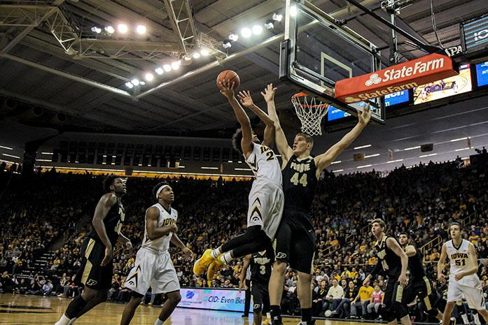 Iowa forward Dom Uhl jumps up to the basket as Purdue Center Isaac Haas extends out to block him, the #9 ranked Iowa Hawkeyes beat the #22 Purdue Boilermakers 83-71 at Carver-Hawkeye Arena in Iowa City, Iowa on Jan. 24, 2016(The Daily Iowan/Anthony Vazquez)