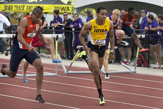 Iowa hurdler Aaron Mallett sprints towards the finish in the men's 110 meter hurdles during the Musco Twilight at the Cretzmeyer Track on Saturday, May 2, 2015. Mallett won the event with a time of 13.69. The Iowa Track and Field team won seven events during the meet. (The Daily Iowan/John Theulen)