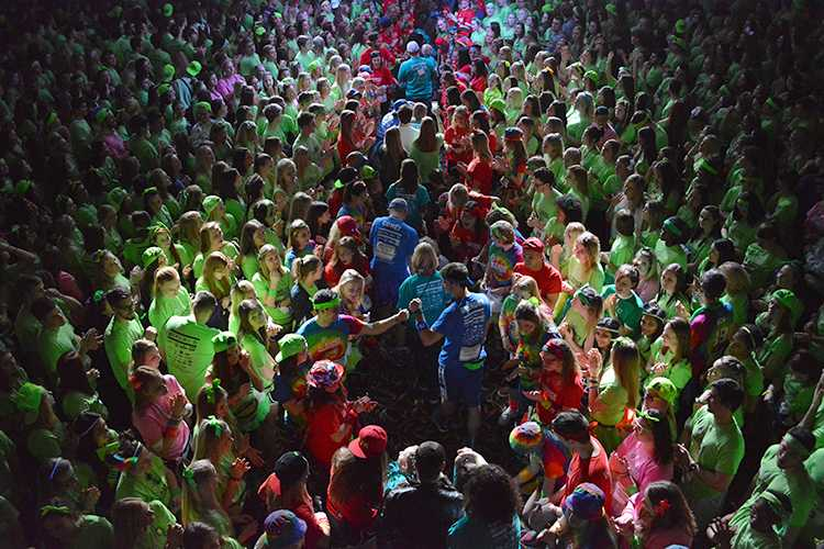 UI students cheer during the opening ceremony of the 22nd Dance Marathon in the Iowa Memorial Union on Friday, Feb. 5, 2016. There are over 220 families in attendance this year. (The Daily Iowan/Valerie Burke)