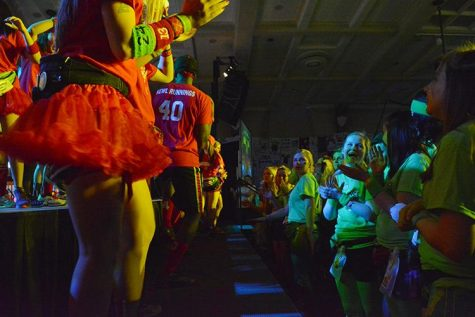 Moral captians start dancing on stage during the second hour of the 22nd Dance Marathon in the Iowa Memorial Union on Friday, Feb. 5, 2016. There are special events happening almost every hour to keep everyone motivated. (The Daily Iowan/Valerie Burke)