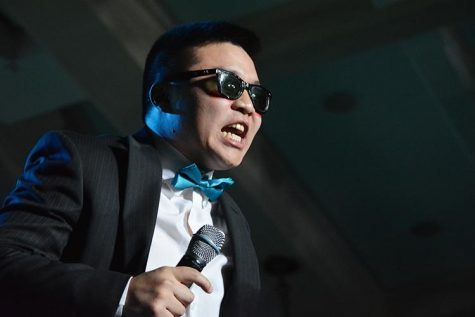Morale captian Clint Donaldson lip syncs 'Gangnam Style' during the male pageant event during the 3rd hour of the 22nd Dance Marathon in the Iowa Memorial Union on Friday, Feb. 5, 2016.