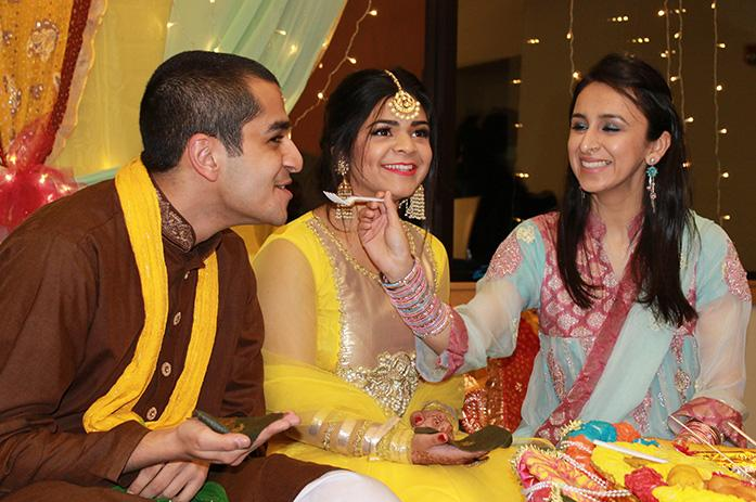 Sharukh+Hasan+and+Ariana+Dewan+are+fed+in+Mehndi+Night%27s+pre-wedding+ceremony+in+the+Old+Capitol+Mall+on+Friday%2C+Feb.+12%2C+2016.+The+Pakistani+Student+Alliance+and+the+South+Asian+Student+Alliance+sponsored+the+event.+