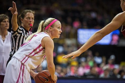 Iowa Guard Whitney Jennings looks for an open teammate while feeling pressure from Indiana during the Women's Basketball game against Indiana at Carver-Hawkeye Arena on Sunday Feb. 21, 2016. The Hawkeyes beat the Hoosiers 76-73 in front of a home crowd of 9,838. (The Daily Iowan/Anthony Vazquez)