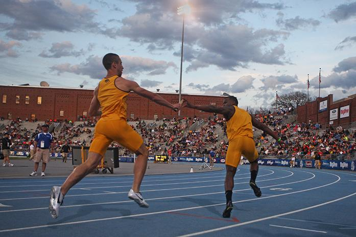 Iowa+runner+Brendan+Thompson+hands+the+baton+off+to+Keith+Brown+in+the+men%27s+4x200+meter+relay+at+Drake+Stadium+on+Friday%2C+April+25%2C+2014.+%28The+Daily+Iowan%2FJoshua+Housing%29