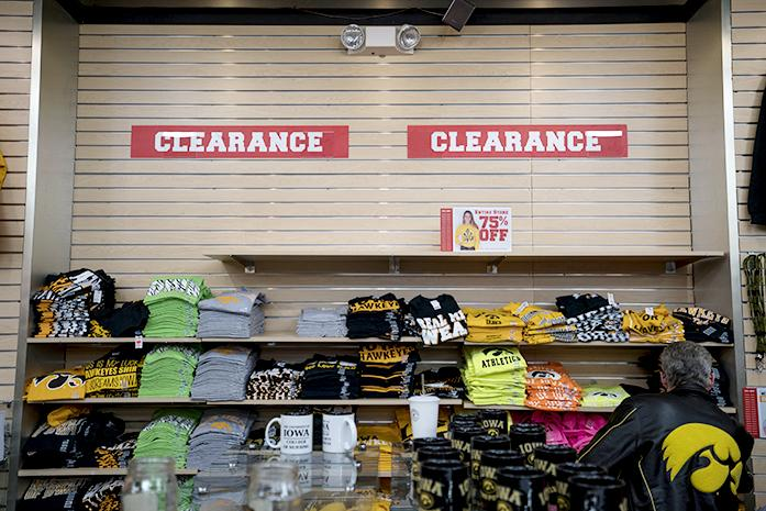 Customers visit Universitees, Old Capitol Town Center, on Wednesday, Feb. 24, 2016. Universitees is having big sale before they close. They will be closing when the product runs out or when their lease ends at March 31, 2016. (The Daily Iowan/Peter Kim)